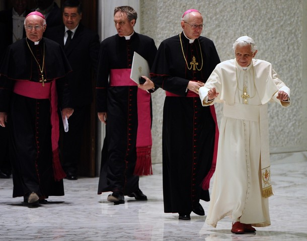 Pope Benedict XVI (R) arrives for a private audince to the metroplolitan archbishops who received their Palliums the day before on June 30, 2011 at the Paul VI hall at the Vatican. AFP PHOTO / VINCENZO PINTO (Photo credit should read VINCENZO PINTO/AFP/Getty Images)